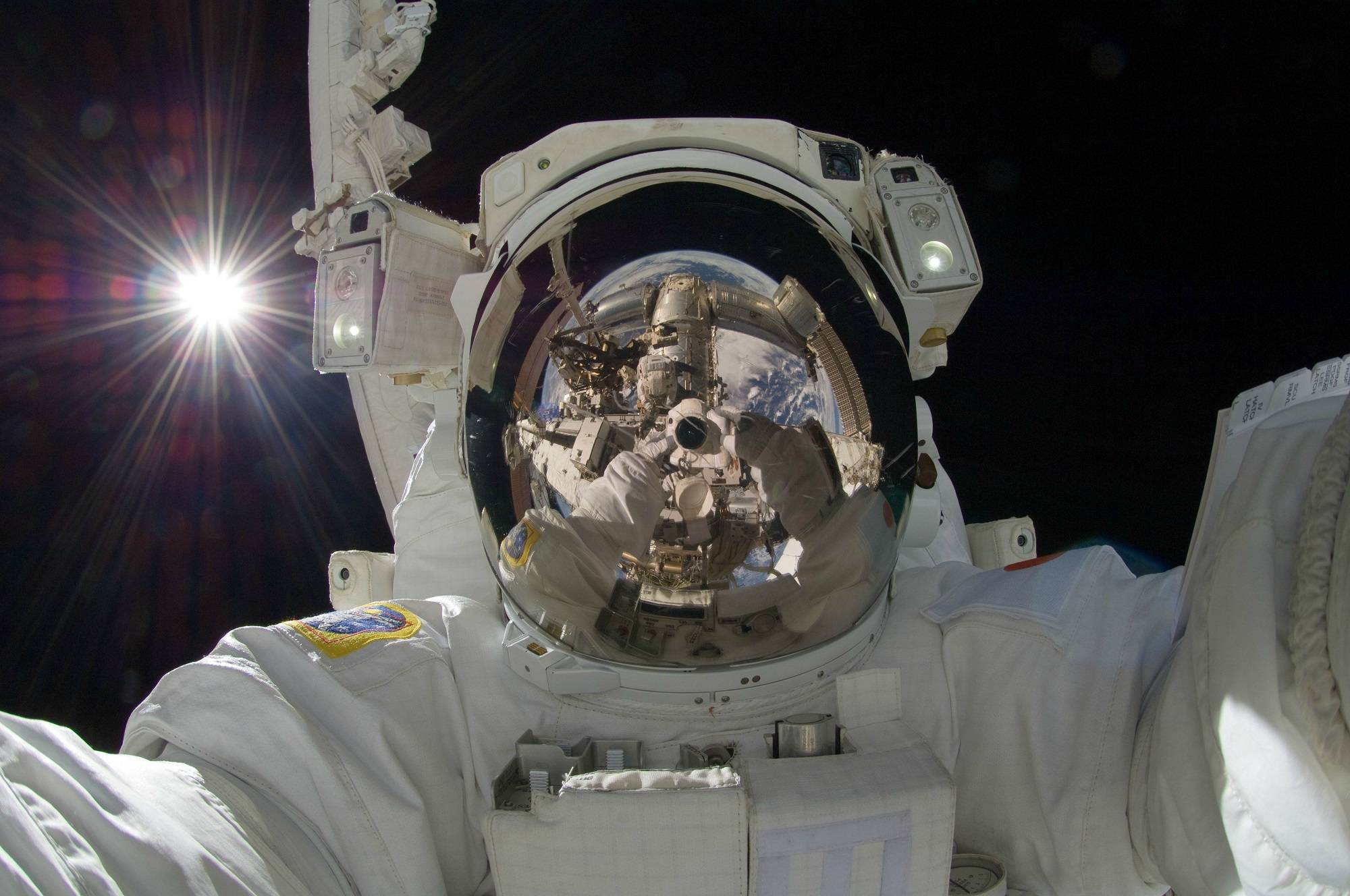 astronaut taking photos in space
